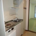 キッチンスペース・写真は411号室のものとなります。